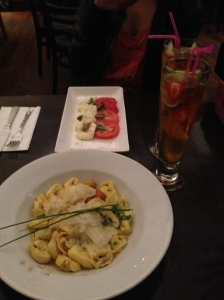 My Pimm's cocktail, a mozzarella salad, and tortelloni at an Italian Restaurant by Leicester Square